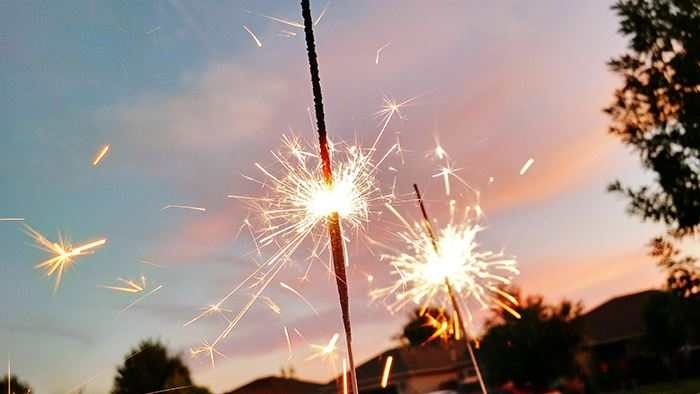 close-up-of-sparkler-against-sky-during-sunset-royalty-free-image-593436249-1559756983-1